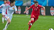 Canada's Christine Sinclair tries to out run China PR's Dongni Wang during a Women's International Friendly soccer match in Moncton, N.B.on Wednesday May 30, 2012. (Marc Grandmaison/CP/Marc Grandmaison/CP)