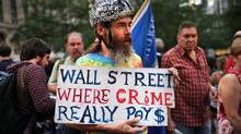 A Wall Street protester holds up a sign at Zuccotti Park where hundreds of other activists are living on Oct. 10, 2011 in New York. (Spencer Platt/Getty Images)