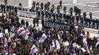 Protesters march in front of the parliament during a 24-hour strike in Athens February 23, 2011.