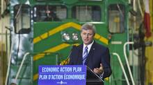 Prime Minister Stephen Harper releases his government's latest economic update at the Irving-owned NB Southern Railway mechanical shop in Saint John on Sept. 28, 2009. (ANDREW VAUGHAN/The Canadian Press)