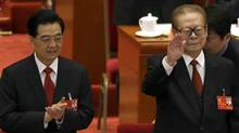 Chinese President Hu Jintao, left, and former president Jiang Zemin arrive for the opening session of the 18th Communist Party Congress held at the Great Hall of the People in Beijing, Nov. 8, 2012. (Ng Han Guan/AP)