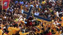 Catholic devotees carry a statue of the Black Nazarene during the annual religious procession in Manila on Jan. 9, 2012. (Erik De Castro/Reuters/Erik De Castro/Reuters)