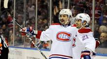 Montreal Canadiens center Tomas Plekanec (L) celebrates a goal with right wing Brian Gionta (21) against the Buffalo Sabres during the first period of their NHL hockey game in Buffalo, New York February 7, 2013. (DOUG BENZ/REUTERS)