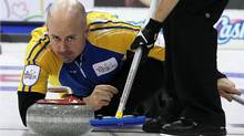 Alberta skip Kevin Koe makes a shot during a morning draw against Newfoundland and Labrador at the Tim Hortons Brier in Saskatoon, March, 6, 2012. (Jonathan Hayward/The Canadian Press/Jonathan Hayward/The Canadian Press)