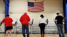 Voters cast their votes during the U.S. presidential election in Elyria, Ohio, U.S. November 8, 2016. (AARON JOSEFCZYK/REUTERS)
