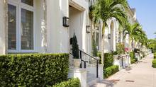 Luxury town homes located in the European-inspired city of Coral Gables located in Miami. Florida is now the third-most populous state behind California and Texas and is still growing quickly. (Raul Rodriguez/iStock)