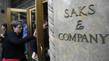 Saks Fifth Avenue store in New York. Hudson's Bay Co. said on Monday that it would buy luxury retailer Saks Inc. for $16 (U.S.) per share, or $2.9-billion in cash, including debt. (SHANNON STAPLETON/REUTERS)