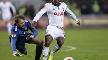 Tottenham's Jermain Defoe, right, controls the ball in front of Anzhi's goalkeeper Evgeni Pomazan during the Europa League group K soccer match between Anzhi Makhachkala and Tottenham Hotspur, at Saturn stadium in Ramenskoye, outside Moscow, Russia, on Thursday, Oct. 3, 2013. (Ivan Sekretarev/AP)