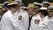 Vice-Admiral Mark Norman, left, greets officers at a change of command ceremony in Halifax on Friday, July 12, 2013. (Andrew Vaughan/THE CANADIAN PRESS)