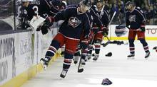 Hats fall onto the ice as \c13 celebrates a hat trick against the Montreal Canadiens during the third period at Nationwide Arena in Columbus, Ohio on January 25, 2016.. Columbus beat Montreal 5-2. (Russell LaBounty/USA Today Sports)