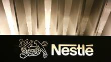The Nestle logo is pictured on the company headquarters entrance building in Vevey, Switzerland. (Pierre Albouy/Reuters)