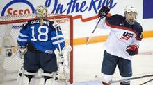 In this March 29, 2016, file photo, United States' Hilary Knight celebrates after scoring against Finland goaltender Meeri Raisanen during a women's world hockey championships game in Kamloops, British Columbia. USA Hockey has postponed the start of the women's national team's world championship training camp amid an ongoing wage dispute. (Ryan Remiorz/AP)