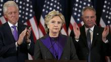 Hillary Clinton, accompanied by her husband, Bill Clinton, and running mate Senator Tim Kaine, addresses her staff and supporters about the results of the U.S. election at a hotel in New York on Nov. 9, 2016. (CARLOS BARRIA/REUTERS)