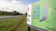 A government action plan sign is seen along theroad near Mississippi Mills, Ont., Monday August 23, 2010. (Adrian Wyld/Adrian Wyld/The Canadian Press)