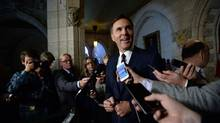 Minister of Finance Bill Morneau speaks to media following a cabinet meeting on Parliament Hill in Ottawa on Tuesday, Sept. 27, 2016. (Sean Kilpatrick/THE CANADIAN PRESS)