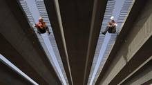 China approved 60 infrastructure projects this week, such as a highway to connect Kashgar and Aksu by the end of Oct. 2013. (STRINGER/CHINA/REUTERS)