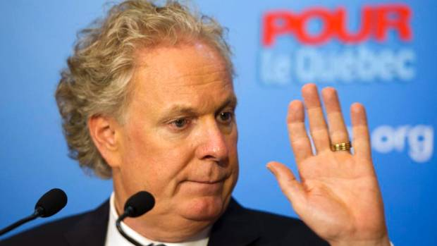 Quebec Liberal Leader Jean Charest speaks to reporters during a news conference Thursday in Montreal.