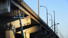Men work on the eastbound section of the Gardiner near Jarvis Street on Jan. 9, 2013. (Fred Lum/The Globe and Mail)