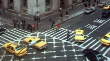 The painted intersection at Fifth Avenue and 57th Street in New York, designed to keep drivers from blocking perpendicular traffic from blocking the way when the light turns red. (1996 file photo) (Adam Nadel/AP Photo)