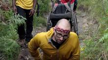 Spencer West climbing Mt. Kilimanjaro on his hands and in his wheelchair to raise money. (Courtesy of Free the Children)