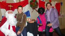 N.S. Liberal Joachim Stroink sits on the lap of Zwarte Piet during a Dutch Christmas event Sunday Dec. 1, 2013 in Halifax. The photo was posted to Twitter before being deleted. (HO/THE CANADIAN PRESS)