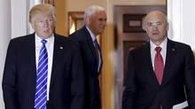In this Nov. 19, 2016, file photo, Donald Trump walks with Labor Secretary-designate Andrew Puzder in Bedminster, N.J. (Carolyn Kaster/AP)
