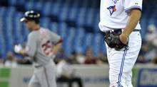 Toronto Blue Jays pitcher Chad Beck stands on the mound after giving up a two-run home run to Washington Nationals batter Adam LaRoche (L) during the third inning of their interleague baseball game in Toronto June 11, 2012. (MIKE CASSESE/REUTERS)