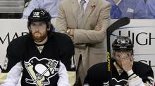 Pittsburgh Penguins coach Dan Bylsma stands behind the bench during the third period of Game 2 of the NHL hockey Stanley Cup playoffs Eastern Conference finals against the Boston Bruins, in Pittsburgh on Monday, June 3, 2013. (Gene J. Puskar/AP)