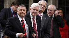 Liberal leader Bob Rae, second left, rises with Ralph Goodale, left, Marc Garneau, Wayne Easter and Hedy Fry as they vote on an amendment to the budget bill C38 on June 14, 2012. (Adrian Wyld/THE CANADIAN PRESS)