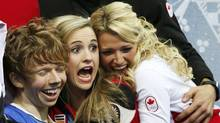 "Kevin Reynolds of Canada celebrates in the ""kiss and cry"" area with teammates during the Team Men Free Skating Program at the Sochi 2014 Winter Olympics on Feb. 9, 2014. (LUCY NICHOLSON/REUTERS)"