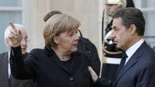 German Chancellor Angela Merkel gestures as she speaks to France's President Nicolas Sarkozy following a joint news conference at the Elysee Palace in Paris, Dec. 5, 2011. France and Germany have agreed on a series of reforms to address the euro zone sovereign debt crisis that will be presented Wednesday. REUTERS/John Schults (FRANCE - Tags: POLITICS BUSINESS) (John Schults/Reuters/John Schults/Reuters)