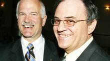 NDP Leader Jack Layton smiles alongside then-candidate Claude Gravelle in Sudbury on April 23, 2005. (JOHN E. LIGHTFOOT JR./CP)