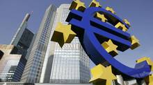 A picture taken 28 June 2005 shows a giant Euro symbol, standing in front of Frankfurt's Eurotower, which houses the European Central Bank (ECB). (JOHN MACDOUGALL/AFP/Getty Images)