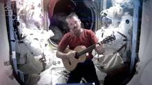 This image provided by NASA shows astronaut Chris Hadfield recording the first music video from space Sunday May 12, 2013. The song was his cover version of David Bowie's Space Oddity. Hadfield and astronaut Thomas Marshburn are scheduled to return to earth Monday May 13, 2013. (Cmdr. Chris Hadfield/AP)