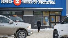 A women enters a Bank of Montreal (BMO) branch, located in Fort McMurray, Alta., in this file photo. (Brett Gundlock for The Globe and Mail)