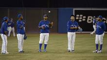 From left, Domincian-born Toronto Blue Jays players Jose Reyes, Edwin Encarnacion, Jose Bautista and Emilio Bonifacio gather during batting practice Monday at Rogers Centre. (Fred Lum/The Globe and Mail)