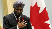 National Defence Minister Harjit Sajjan gestures after being sworn-in during a ceremony at Rideau Hall in Ottawa, Nov. 4, 2015. He has ordered Canada's top soldier to make suicide in the military a top priority, after a surgeon general's report showed an increase in suicide rates among those in the military in the past decade. (BLAIR GABLE/REUTERS)