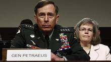 U.S. General David Petraeus testifies at his Senate Armed Services Committee confirmation hearing to become commander of U.S. forces in Afghanistan on Capitol Hill in this June 29, 2010 file photo. (KEVIN LAMARQUE/REUTERS)