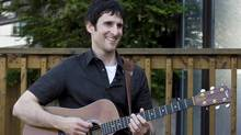 Musician Dave Carroll of the pop-folk band Sons Of Maxwell holds his repaired Taylor guitar in Halifax. (ANDREW VAUGHAN)
