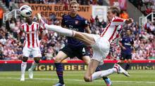 Stoke City's Peter Crouch stretches for the ball during their English Premier League soccer match against Arsenal at the Britannia Stadium in Stoke-on-Trent, central England, August 26, 2012. (DARREN STAPLES/REUTERS)