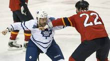 Florida Panthers' George Parros (22) and Toronto Maple Leafs' Colton Orr (28) fight during the first period of an NHL hockey game in Sunrise, Fla., Monday, Feb. 18, 2013. (Associated Press)