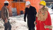 Tory MP Shelly Glover tours the construction site at the Salvation Army Multicultural Family Centre in Winnipeg as party of a Harper government PR blitz on Feb. 24, 2011. (David Lipnowski/THE CANADIAN PRESS)