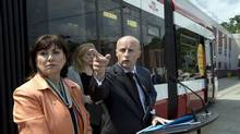 Toronto Transit Commission chair Maria Augimeri, left, and TTC CEO Andy Byford answer questions after introducing a new streetcar in Toronto on July 31, 2014. (Frank Gunn/The Canadian Press)