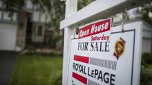 A for sale real estate sign is seen in the front of a house in Markham in this file photo. (Mark Blinch/Globe and Mail)