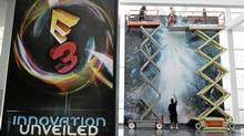 Workers finish final preparations for E3 2012, the Electronic Entertainment Expo, an annual video game conference and show, at the Los Angeles Convention Center in Los Angeles, June 3, 2012. (JONATHAN ALCORN/REUTERS)