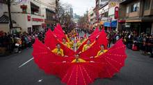 Dancers perform as the 41st annual Chinese New Year parade moves along East Pender Street in Vancouver, B.C., on Feb. 2, 2014. (DARRYL DYCK/THE CANADIAN PRESS)