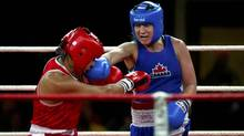 Canadian boxer Mary Spencer (blue) and Mexican boxer Alma Nora Ibarra (red) compete at the Women's Elite Continental Championships in Cornwall, Ont. Wednesday, April 4/2012. (Kevin Van Paassen/The Globe and Mail)