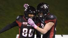 Ottawa Redblacks' Juron Criner (86) celebrates his touchdown against the Hamilton Tiger-Cats with teammate Greg Ellingson (82) during first half CFL action on Friday, Oct. 21, 2016 in Ottawa. Suiting up for the Grey Cup is becoming pretty familiar for Ellingson. (Justin Tang/THE CANADIAN PRESS)