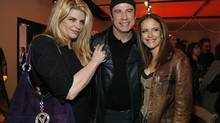 "John Travolta, middle, and his wife Kelly Preston, right, pose with actress Kirstie Alley at the after party for the world premiere of ""Wild Hogs"" in Hollywood in this February 27, 2007 file photo. (MARIO ANZUONI/REUTERS)"