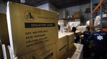 On Oct 15 2014, volunteers pack boxes of supplies to help in the fight against the ebola crisis in Liberia. Boxes of gowns, masks and face shields were loaded into a container that will head to Halifax where it will be shipped by boat to the west African country. (Fred Lum/The Globe and Mail)